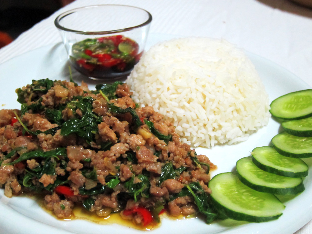 Pad Krapow Muu served with Prik Nam Bplaa and sliced cucumber