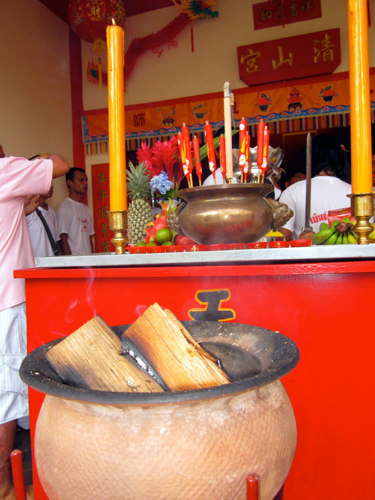 Insence, candles and buring wood, Khao Lak Temple