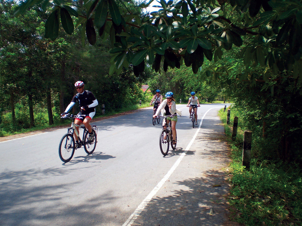 Mountain biking the quiet roads around Thai Muang Thailand