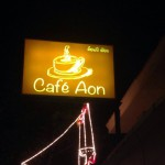 Cafe Aon sign at night