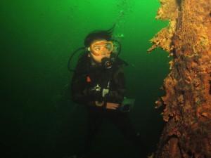 Diver checks out a tree in Khao Sok Lake Thailand