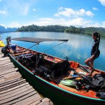 Diving long tail boat visits the raft house in Khao Sok Lake