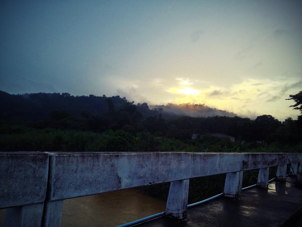 Sun breaks through the clouds near Takua Pa, Thailand